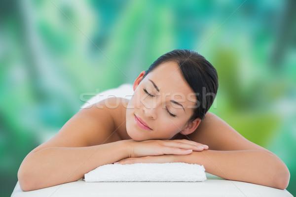 Beautiful brunette relaxing on massage table  Stock photo © wavebreak_media