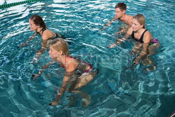 Fitness klasse onderwater oefening fietsen zwembad Stockfoto © wavebreak_media