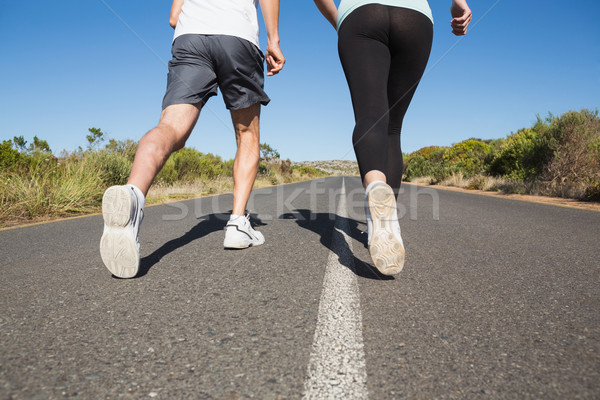 Fit couple running on the open road together Stock photo © wavebreak_media