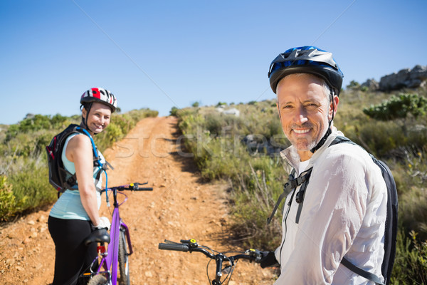 Active couple cycling on country terrain together Stock photo © wavebreak_media