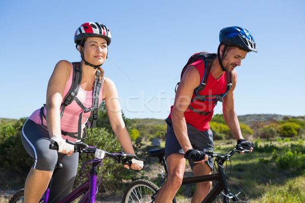 Stock photo: Active couple cycling in the countryside