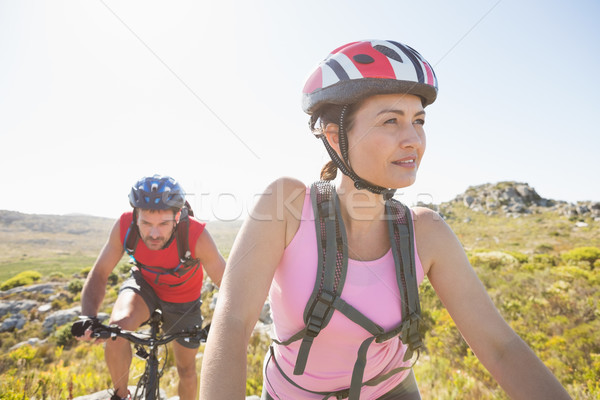 Fit cyclist couple riding together on mountain trail Stock photo © wavebreak_media