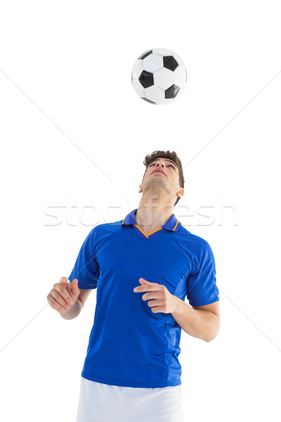 Football player in blue jersey heading ball Stock photo © wavebreak_media