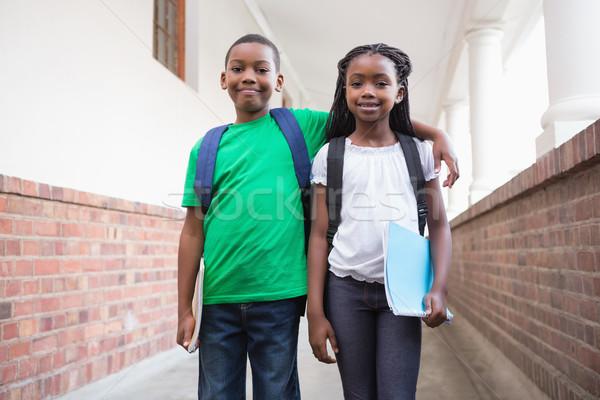 Bonitinho alunos sorridente câmera corredor escola primária Foto stock © wavebreak_media