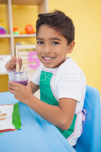 Cute little boy painting at table in classroom Stock photo © wavebreak_media