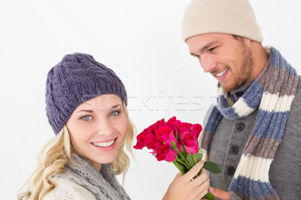 Atrakcyjny para ciepłe ubrania kwiaty Zdjęcia stock © wavebreak_media