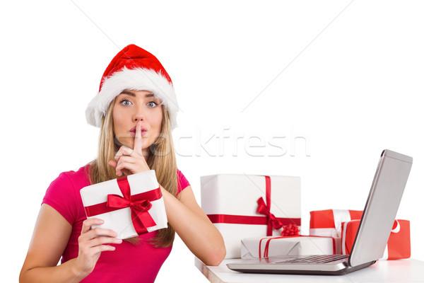 Festive blonde shopping online with laptop Stock photo © wavebreak_media