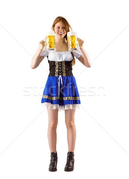 Stock photo: Oktoberfest girl holding jugs of beer