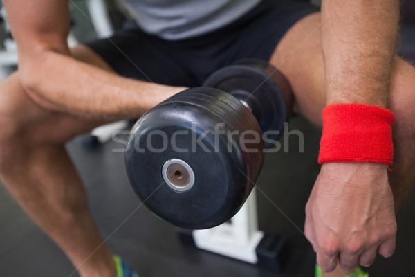 Mid section of man exercising with dumbbell in gym Stock photo © wavebreak_media