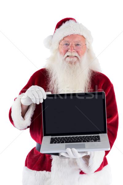 Santa Claus presents a laptop Stock photo © wavebreak_media
