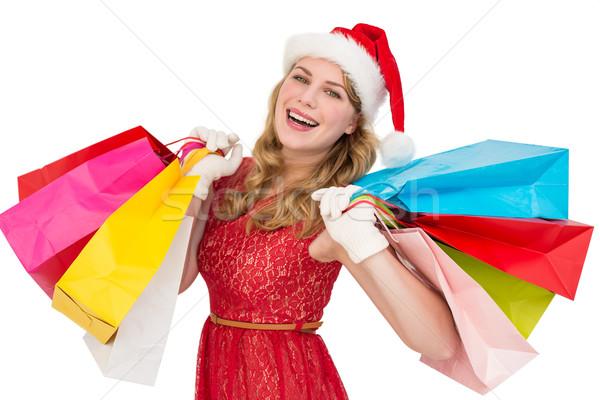 Excited blonde in santa hat holding shopping bags Stock photo © wavebreak_media