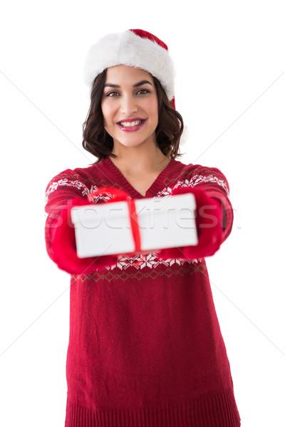 Smiling brunette in red gloves holding gift Stock photo © wavebreak_media