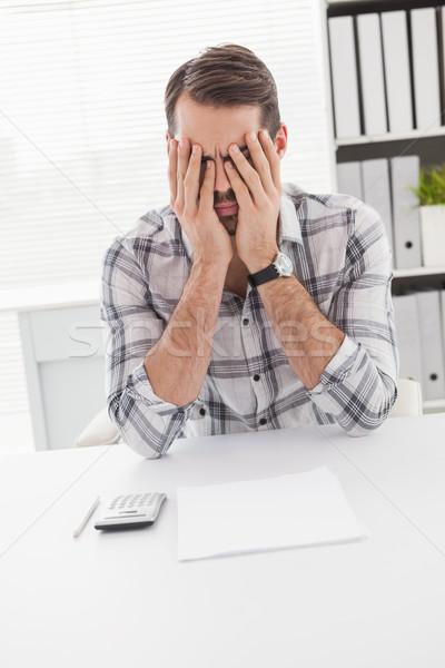Casuale imprenditore sentimento desk ufficio Foto d'archivio © wavebreak_media