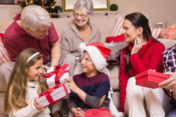 Multi generation family exchanging presents on sofa Stock photo © wavebreak_media