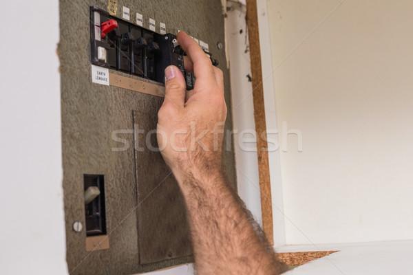 Electrician working on the fuse box Stock photo © wavebreak_media