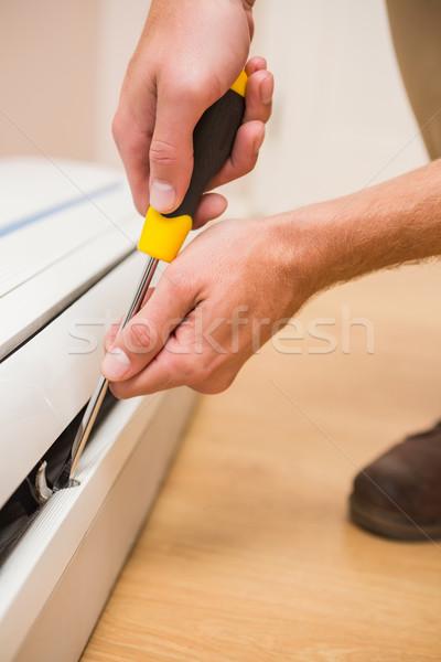 Handyman fixing an air conditioning Stock photo © wavebreak_media