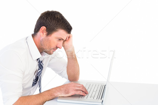 Focused businessman working on his laptop Stock photo © wavebreak_media