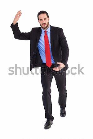 Unsmiling businessman holding something with hands Stock photo © wavebreak_media