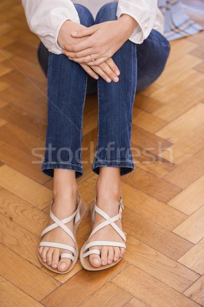 Mid section of girl sitting on the floor Stock photo © wavebreak_media