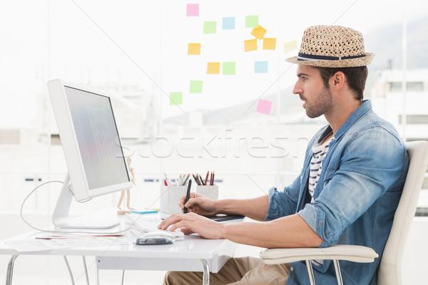 Casual designer using computer and digitizer Stock photo © wavebreak_media