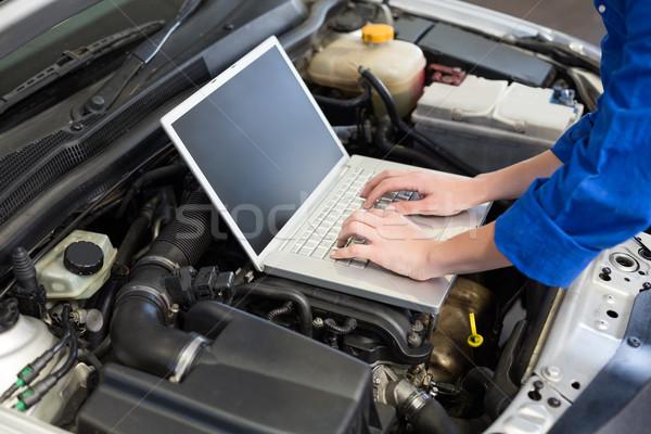 Mechanic using laptop on car Stock photo © wavebreak_media