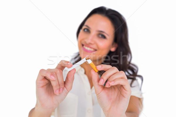 Pretty brunette breaking a cigarette Stock photo © wavebreak_media