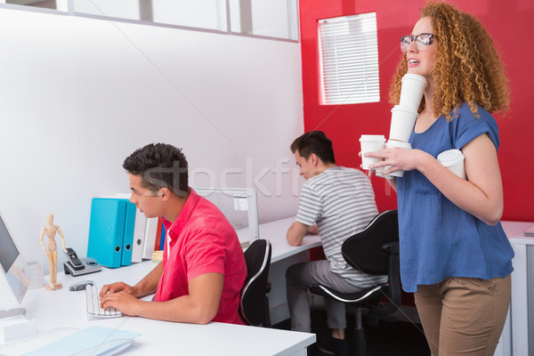 Student holding pile of coffee cup Stock photo © wavebreak_media