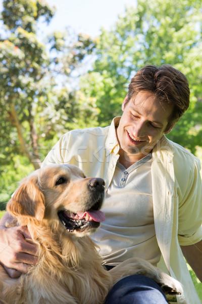Happy man with his pet dog in park Stock photo © wavebreak_media