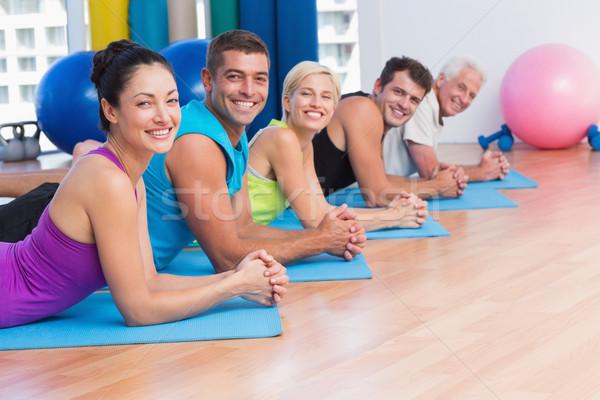 People relaxing on exercise mats in fitness studio Stock photo © wavebreak_media