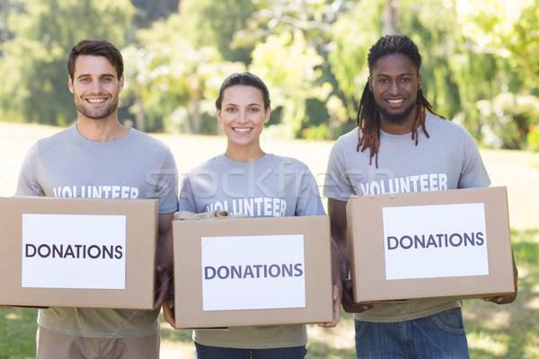 Feliz voluntarios donación cajas parque Foto stock © wavebreak_media