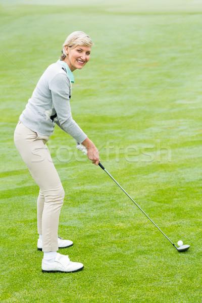 Lady гольфист зеленый туманный день гольф Сток-фото © wavebreak_media
