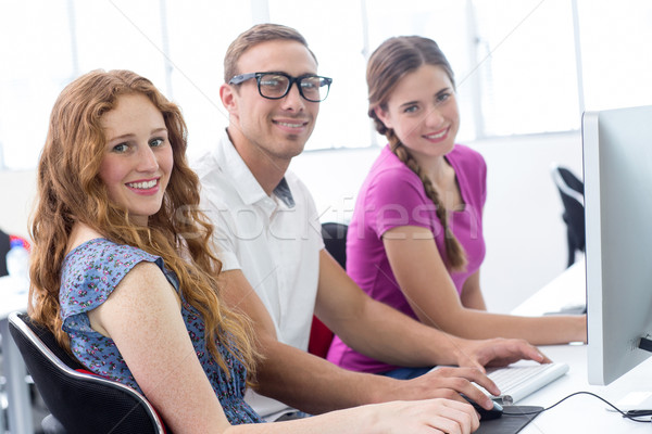 студентов улыбаясь камеры компьютер класс портрет Сток-фото © wavebreak_media