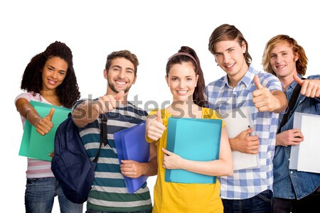 College students gesturing thumbs up Stock photo © wavebreak_media