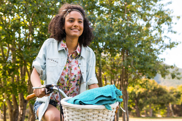 Pretty hipster riding her bike Stock photo © wavebreak_media