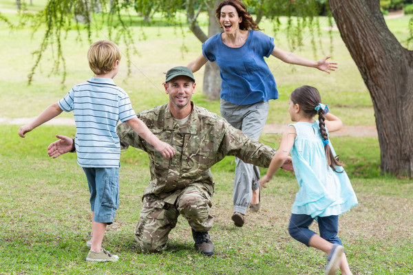 Handsome soldier reunited with family  Stock photo © wavebreak_media