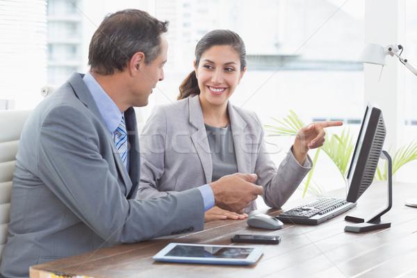 Businesswoman working with team mate Stock photo © wavebreak_media