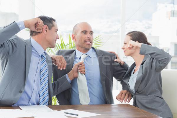 Business partners fighting together Stock photo © wavebreak_media