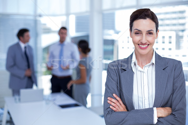 Sonriendo mujer de negocios los brazos cruzados oficina hombre feliz Foto stock © wavebreak_media