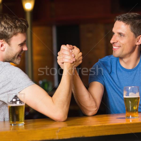Mutlu arkadaş bilek güreşi diğer bar adam Stok fotoğraf © wavebreak_media