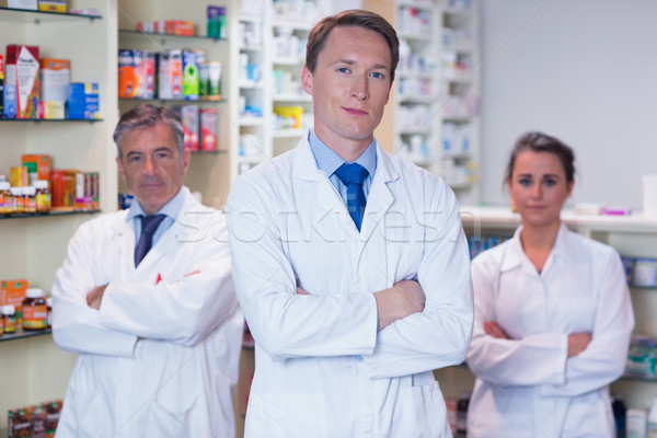 Smiling pharmacy team standing with arms folded Stock photo © wavebreak_media