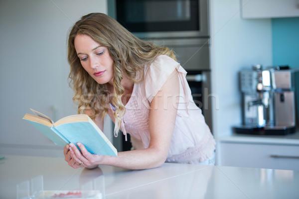 Pretty blonde reading a book  Stock photo © wavebreak_media