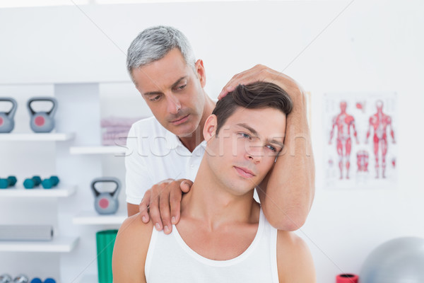 Orvos nyak beállítás orvosi iroda kezek Stock fotó © wavebreak_media