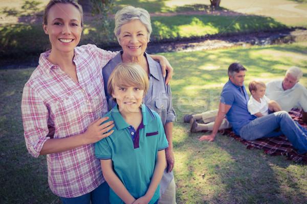 Happy family smiling at the camera  Stock photo © wavebreak_media