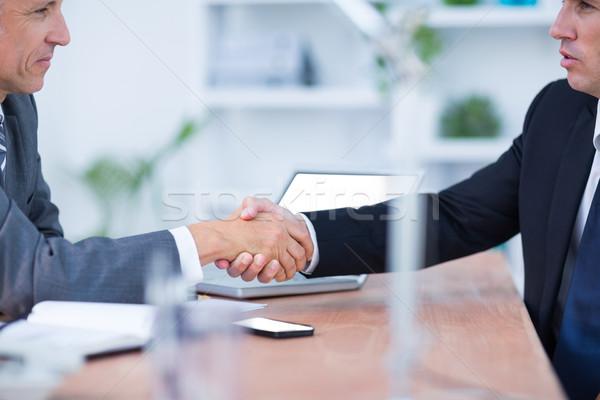 Due imprenditori stringe la mano lavoro ufficio uomo Foto d'archivio © wavebreak_media