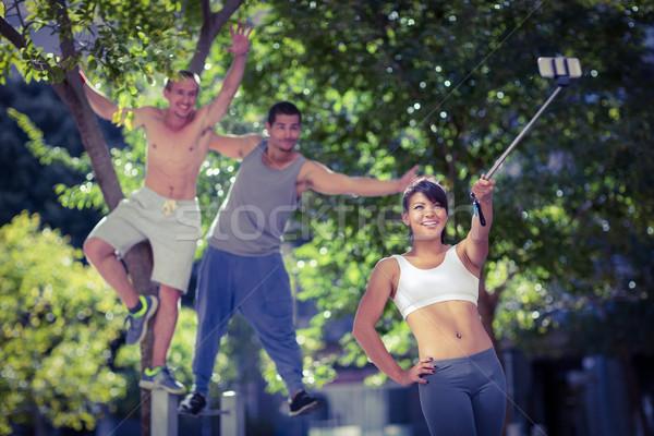 Mosolyog extrém sportolók elvesz tavasz épület Stock fotó © wavebreak_media
