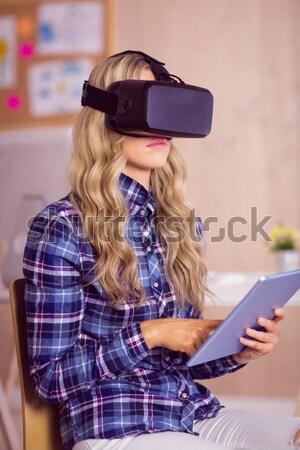 Pretty casual worker using oculus rift Stock photo © wavebreak_media