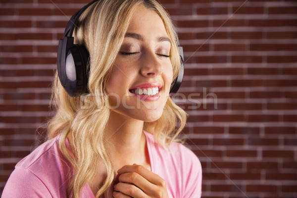 Close up of a woman listening to music  Stock photo © wavebreak_media