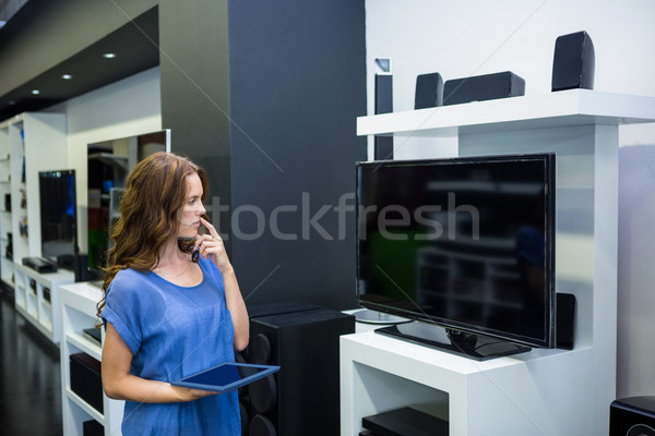 Pretty woman shopping for new television Stock photo © wavebreak_media