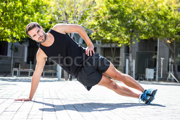 Handsome athlete doing a side plank Stock photo © wavebreak_media