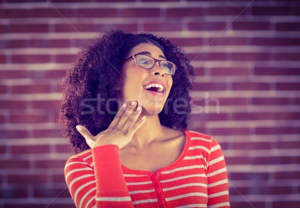驚いた 魅力的な 若い女性 赤 レンガ 幸せ ストックフォト © wavebreak_media
